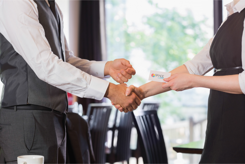 shaking hands, business card, changing accountants